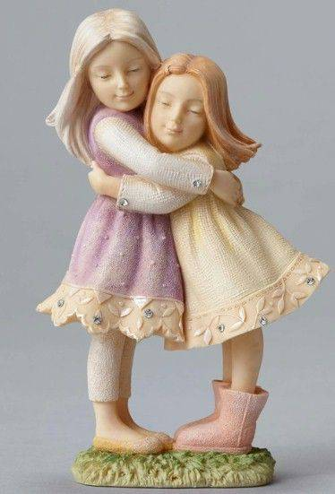 Children Hugging Figurine