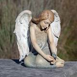 "from the beloved Josephs Studio Collection, this sweet angel sits quietly with a bluebird at her side. Resin/Stone mix. Gift Boxed. ??9.75""H X 8.5""L X 8.5""W"