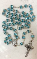Pope Francis Aqua Colored Crystal Bead Rosary features Pope Francis crest and Papal Crucifix. From Italy.