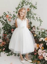 Brooke White First Communion Dress V Neckline Glitter Tulle Dress with a Removable Rhinestone Brooch. The back has a Center zipper and a sash tie back