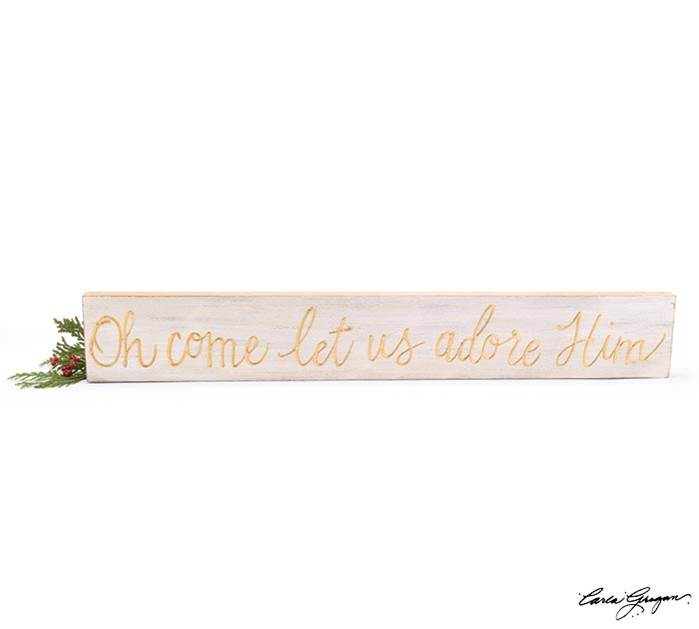 Long white distressed wall hanging with raised gold message: Oh come let us adore him.  Made of hand painted wood