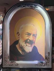 "Padre Pio Canvas in Silver/Wood Frame   Beautiful full color canvas carefully mounted in a silver plated frame with solid wood backing. Can hang or stand with included back stand. Measures 13.5"" tall x 10.25"" wide. Gift Boxed. ?Made in Italy."
