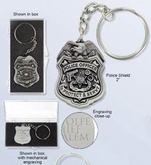 "Police Shield Key Chain made with antique pewter finish; Made in the USA. 2"" policeman medal on key ring. Comes gift boxed and personalized for FREE!  This item ships direct from the manufacturer and comes with FREE BACKSIDE ENGRAVING and FREE Standard USP"