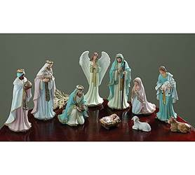 Hand-painted resin Victorian style nativity in pastel colors with gold accents